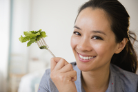 Chinese woman eating salad