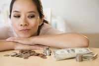 Chinese woman contemplating finances