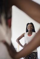 Black woman admiring herself in mirror