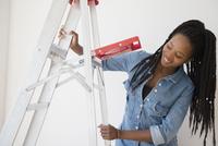 Black woman opening ladder