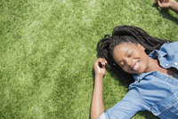 Black woman laying in grass