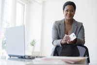 Black businesswoman holding cell phone