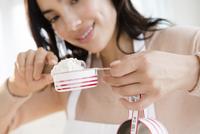 Hispanic woman measuring flour