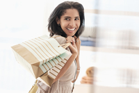 Hispanic woman carrying shopping bags