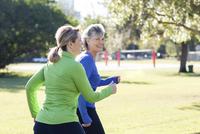 Caucasian women jogging in park