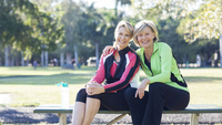 Caucasian women sitting on picnic table in park