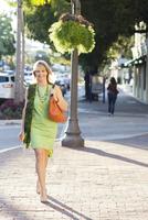 Caucasian woman walking on city sidewalk