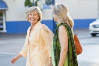 Caucasian women walking in city
