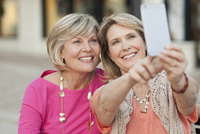 Caucasian women taking selfie with cell phone