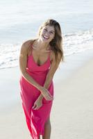 Caucasian woman walking on beach