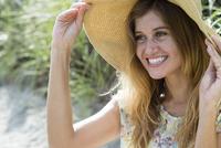Caucasian woman wearing sun hat on beach