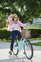 Caucasian woman riding bicycle