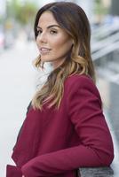 Hispanic businesswoman standing outdoors