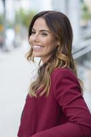 Hispanic businesswoman smiling outdoors