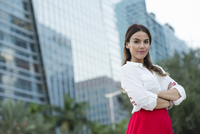 Hispanic businesswoman smiling outdoors