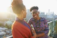 Women talking on city rooftop
