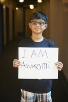 Indian boy holding empowering sign