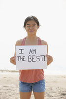 Chinese teenage girl holding empowering sign