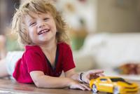 Caucasian boy playing with toy car