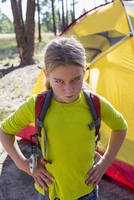 Caucasian girl frowning at campsite