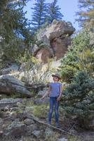 Caucasian girl exploring hillside