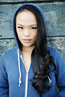 Asian woman wearing hoodie