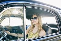Caucasian woman driving vintage car