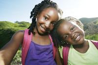 Black girls smiling outdoors