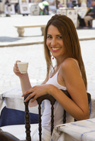 Caucasian woman drinking coffee outdoors