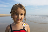 Mixed race girl smiling on beach