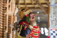 Traditional dancer standing in Buddhist temple, Kintamani, Bali, Indonesia