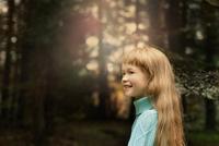 Caucasian girl walking in forest