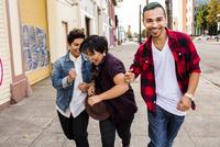Friends walking on sidewalk