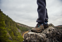 Man standing on rock in remote valley