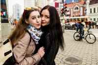 Caucasian women hugging outdoors