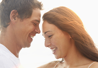 Couple laughing outdoors