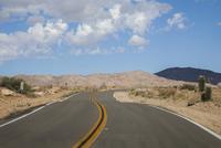 Empty road in rural desert landscape
