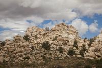 Desert rock formations under cloudy sky