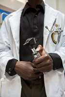 Close up of doctor holding medical tool in hospital