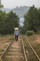 Woman walking on steps on rural hillside