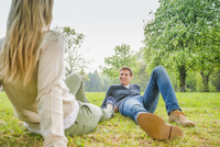 Caucasian couple laying in grass