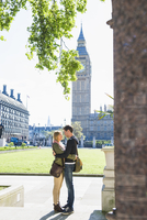 Caucasian couple hugging on vacation, London, Middlesex, United Kingdom