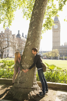 Caucasian couple hugging tree, London, Middlesex, United Kingdom