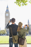 Caucasian couple photographing clock tower, London, Middlesex, United Kingdom