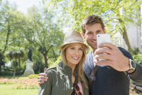 Caucasian couple taking selfie outdoors