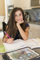 Mixed race girl doing homework