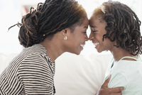 Black mother and daughter touching noses