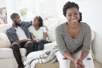 Black mother sitting in living room