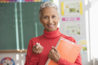 Mixed race teacher smiling in classroom