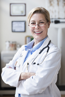 Caucasian doctor smiling in clinic